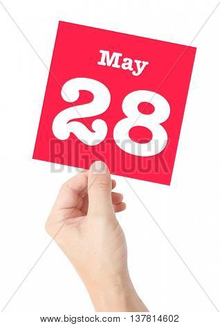 May 28 written on a card held by a hand