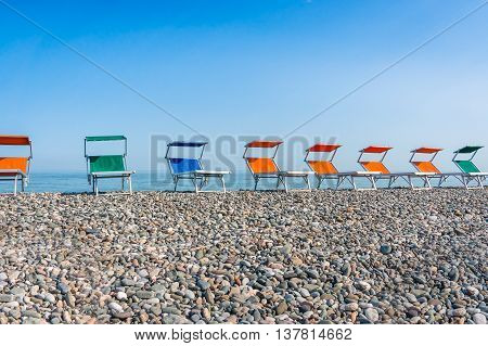 Colorful Beach Chairs On The Shingle Beach