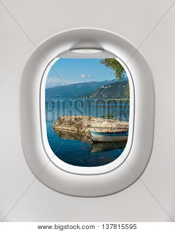 Looking Out The Window Of A Plane To The  Ohrid Lake
