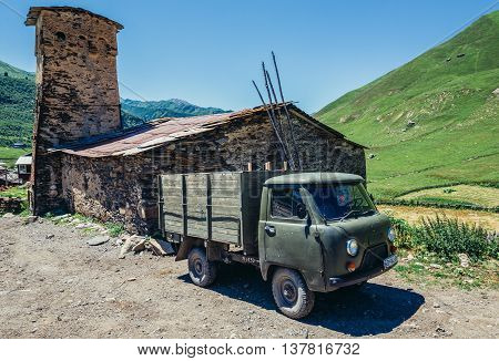 Ushguli Georgia - July 24 2015. Characteristic for the entire Svaneti region stone defensive towers in small village Zhibiani part of Ushguli community in Svaneti region
