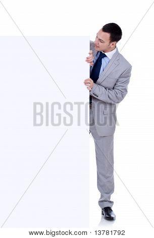 Man Peeking Behind Empty Board