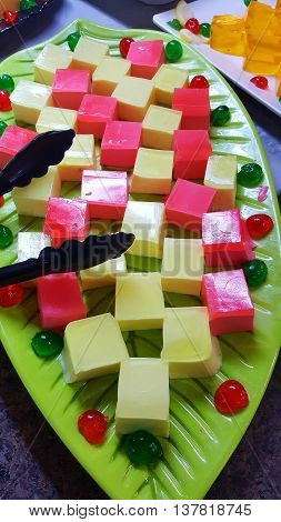 a tray of colored and delicious fruit jelly