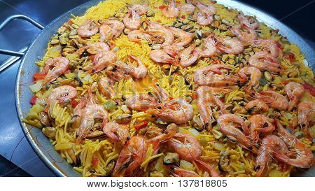 a typical paella with dish  from Spain