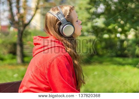 Young Lady Listening To Music And Relaxing