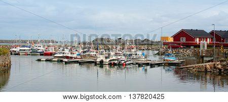 Fishing boat into harbour in Lofoten Island Norway