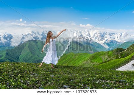 Grassy Valley And Beautiful Dancing Girl In White Wedding Dress