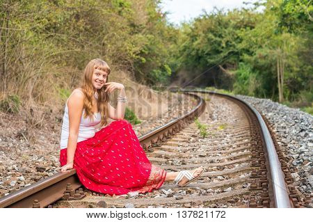 Young Lady Sitting On Railway Tracks