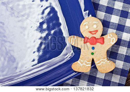 smiling gingerbread man on a blue plate