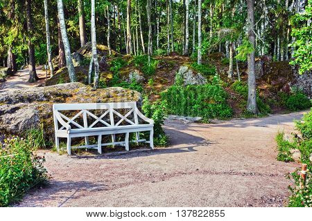 white decorative bench for relaxing in the park