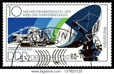 STAVROPOL RUSSIA - July 08 2016: a stamp printed by GDR shows Cable-Laying Vechcle Dish Antenna circa 1980