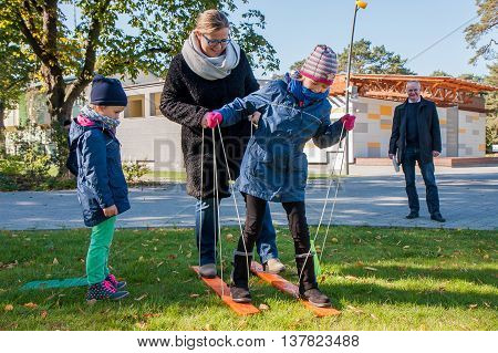 Jozefow Poland - October 10 2015: Parents with children playing various games on the grass in the park in city center