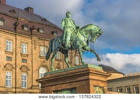 Christiansborg Palace And Statue Of Christian Ix Illuminated In Early Morning, Copenhagen, Denmark