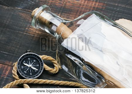 compass a rope and a message in a bottle
