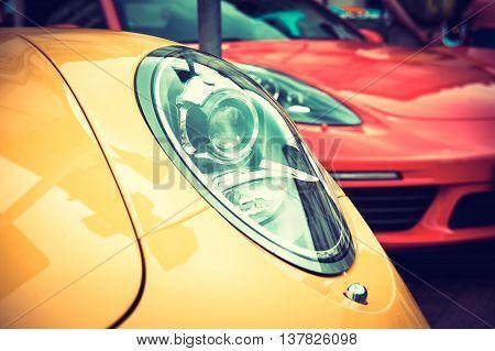 Close up of a yellow sport car: headlights