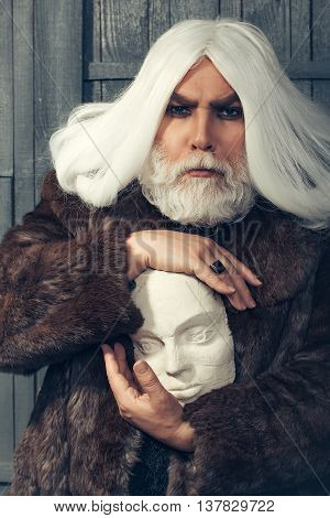 Bearded Man With Sculpture Head