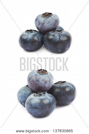 Pile of ripe bilberries isolated over the white background, set of two different foreshortenings