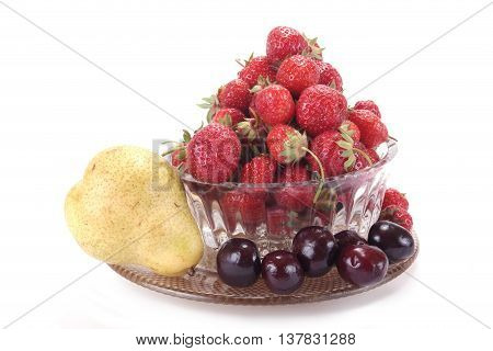 Berries of strawberry and merry in a glass vase on a white background