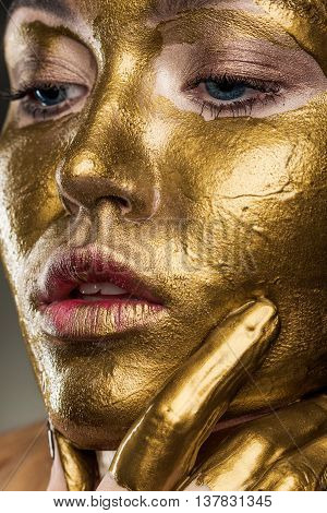 Close Up Portrait Of A Woman With Yellow Paint On His Face