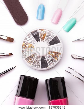Manicure and pedicure tools on white. Studio shot