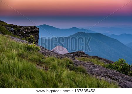 Sunrise Behind Tent on Rocky Outcrop in the Blue Ridge Mountains