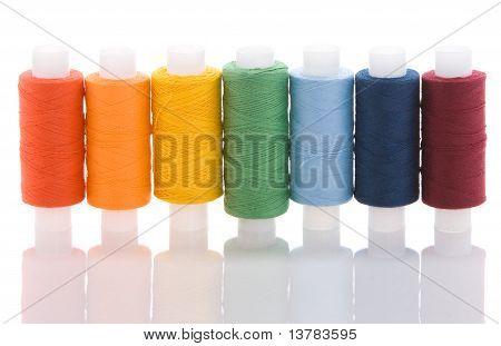 Seven colored spools