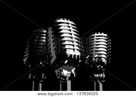 Three Silver retro microphones symbolizing trio, backing vocalist or a trio of singers. 3D illustration