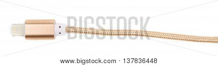 Close-up fragment of the golden USB lightning cable isolated over the white background