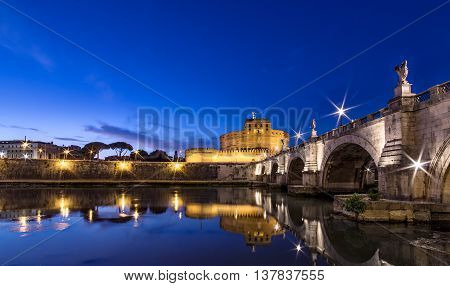 Night view after sunset on Saint Angelo Castle in Rome.