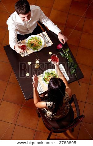 Above view of couple celebrating Valentine?s Day in the restaurant