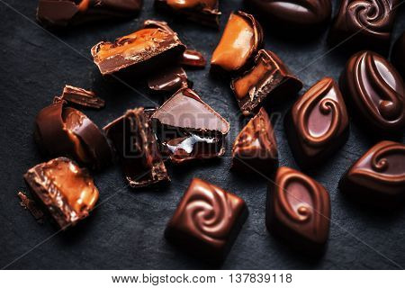 Chocolate Candy Sweet Wallpaper- sweet food collection. Dark Chocolate Candies over black background.