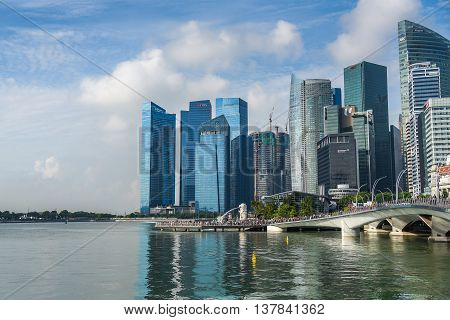 SINGAPORE - MAY 6 2016 : Cityscape of Singapore business district skyline near Marina Bay and Jubilee bridge link to Merlion Park.