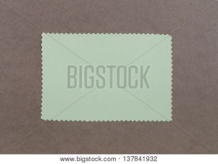 Paper note is empty space on brown wooden for design background and you can input text to it.