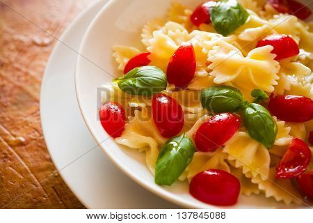 Closeup of Farfalle pasta with cherry tomatoes and basil
