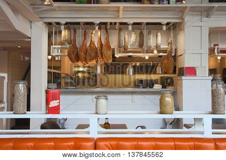 Hanging ham sausages and cereal counter cafe, restaurant in the bright tree