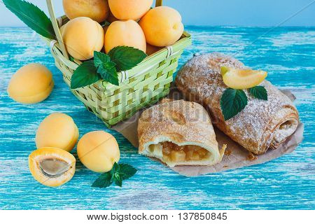 Apricots In The Basket And Baked Goods