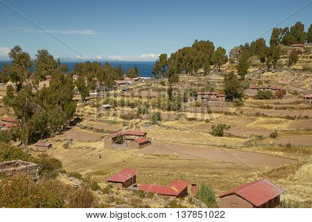 Houses of Local Peruvian Peope Living on Taquile Island (Isla Taquile) at Lake Titicaca in Puno Peru.