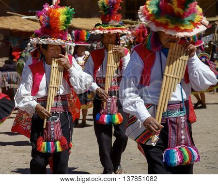 TAQUILE PERU - JULY 29 2012: Musicians and Dancers During a Festival on Taquile Island at Lake Titicaca in Puno Peru.