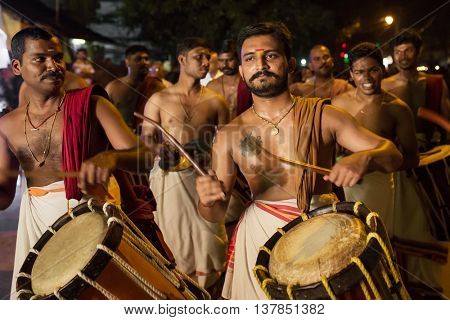 Kochi, India -  December 31, 2015: Traditional south indian drummers performing on streets of Kochi, Indian