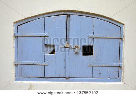 blue retro wooden door of a basement area