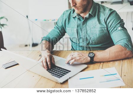 Department Economist Working Wood Table Laptop Modern Interior Design Loft Place.Businessman Work Coworking Studio.Man Use Contemporary Notebook, Typing Keyboard.Blurred Background. Business Startup