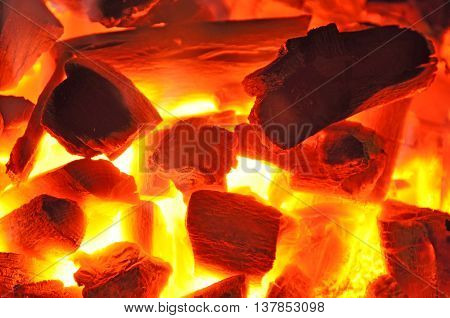 Wood fire with flames, charcoal and embers