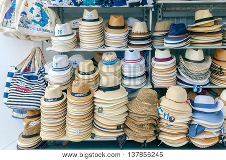 Fira, Greece - May 2, 2016: Various hats and bags in the gift shop on Santorini. The Greek islands are one of the most visited tourist destinations in Europe.