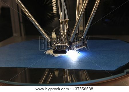detail of 3d printer printing a plastic piece