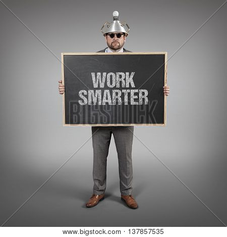 Work smarter text on blackboard with science businessman holding blackboard sign