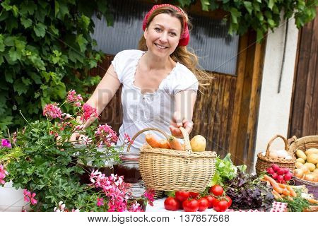A market woman offers fresh vegetables at a market stall