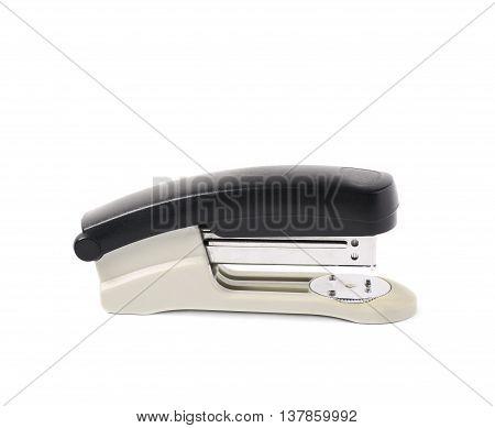 Black office stapler isolated over the white background