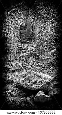 Vertical black and white landslide rock landscape