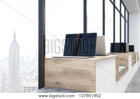 Closeup of blank laptop on wooden hipster windowsill workplace with panoramic New York city view. Mock up 3D Rendering