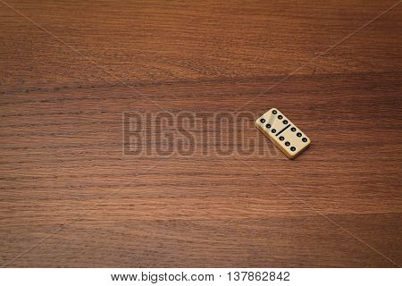 dominoes on a wooden table number double six