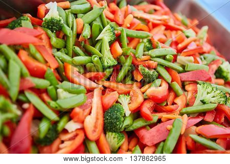 Broccoli, carrots and green beans in a pan stirfry